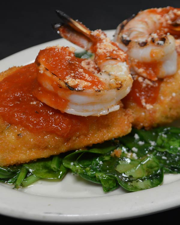 Italian Food - Fried Ravioli and Shrimp Over Spinach