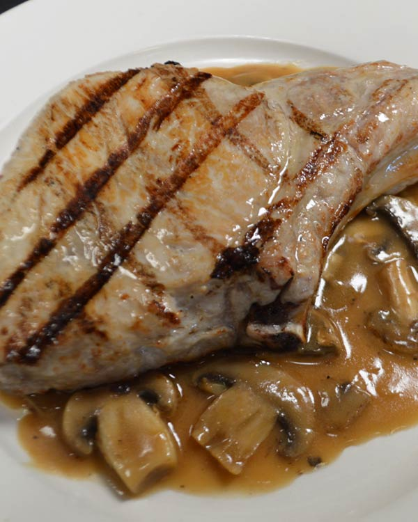 Italian Food - Grilled Pork Chops With A Mushroom Sauce