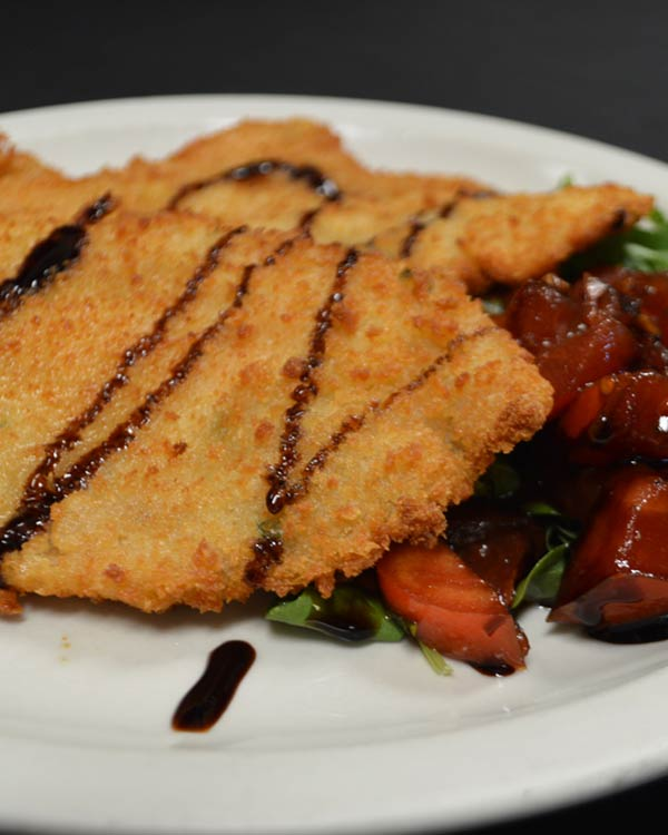 Italian Food - Veal Milanese With A Raspberry Compote