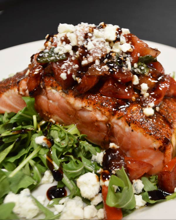 Blanckened Salmon With Feta Cheese and Raspberry Vinaigrette Over Fresh Spinach