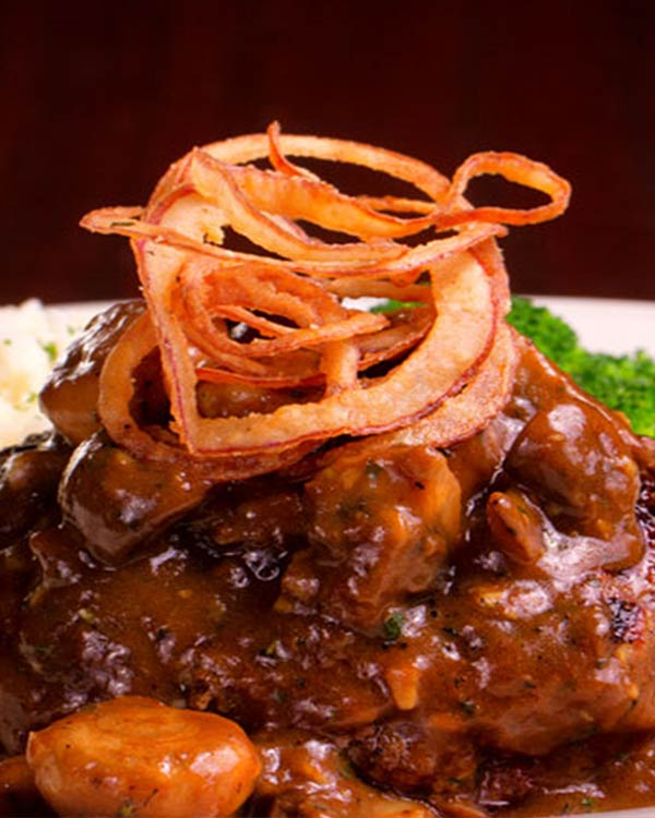 Meatloaf Smothered With Mushrooms and Light Brown Wine Sauce